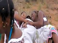 African slaves blowing cocks and banging outdoors